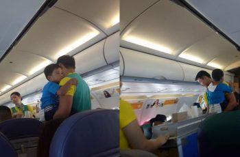 Cabin-Crew-Astounds-Netizens-When-He-Carries-Little-Boy-While-Serving-Flight-Passengers