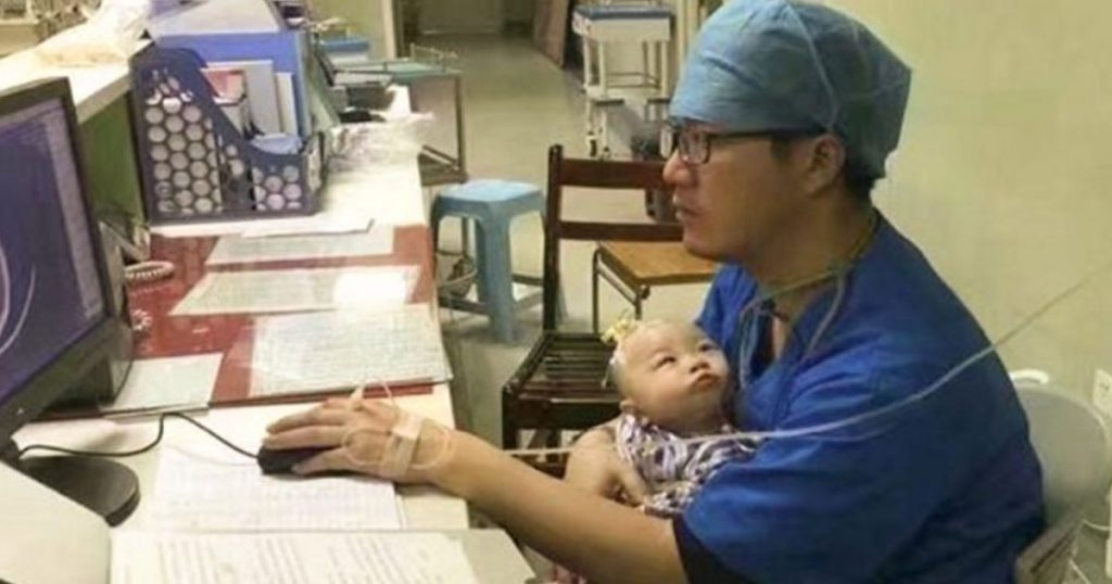 Pediatric-Doctor-Turns-'Human-Pacifier'-to-Crying-Baby,-Inspires-Netizens